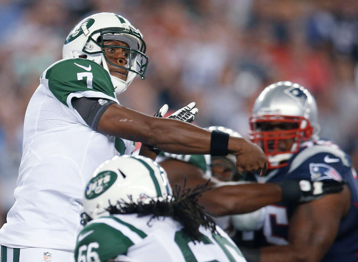 New York Jets quarterback Geno Smith (7) follows through on a pass in front of New England Patriots defensive tackle Vince Wilfork, right, during the first quarter of an NFL football game Thursday, Sept. 12, 2013, in Foxborough, Mass. (AP Photo/Elise Amendola)