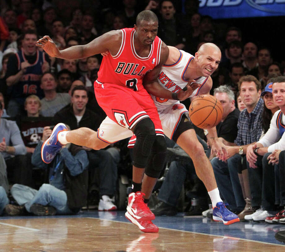 Chicago Bulls' Luol Deng, left, and New York Knicks' Jason Kidd chase a loose ball during the first half of an NBA basketball game on Friday, Dec. 21, 2012, at Madison Square Garden in New York. (AP Photo/Mary Altaffer) / AP