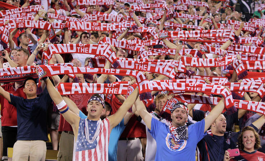 United States fans hold up scarves as they sing the national Anthem before the start of the qualifying soccer match against Mexico in a World Cup, Tuesday, Sept. 10, 2013, in Columbus, Ohio. (AP Photo/Jay LaPrete) / FR52593 AP