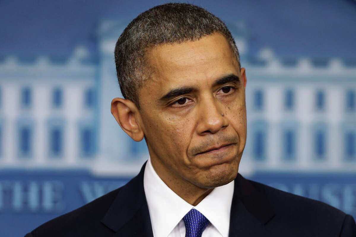President Barack Obama pauses as he speaks to reporters about the fiscal cliff in the Brady Press Briefing Room at the White House in Washington, Friday, Dec. 21, 2012. (AP Photo/Charles Dharapak)