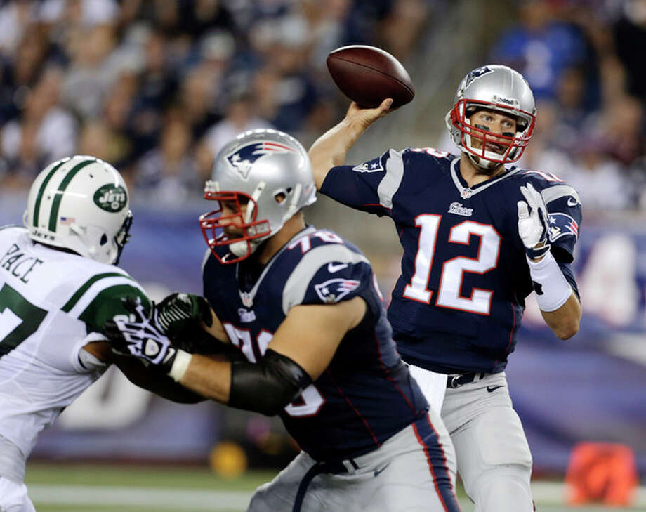 New England Patriots quarterback Tom Brady (12) passes against the New York Jets in the first quarter of an NFL football game Thursday, Sept. 12, 2013, in Foxborough, Mass. (AP Photo/Charles Krupa) / AP