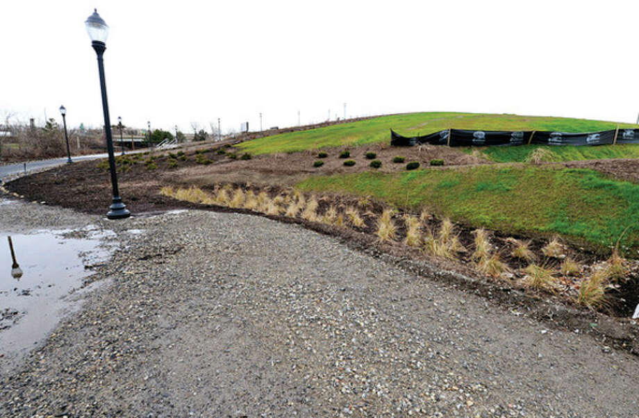 Phase One improvements to Oyster Shell Park are near completion Thursday. The project added drainage, hardscape, landscaping and lighting to the hillside park adjacent to the Norwalk River and Interstate 95.Hour photo / Erik Trautmann / (C)2012, The Hour Newspapers, all rights reserved