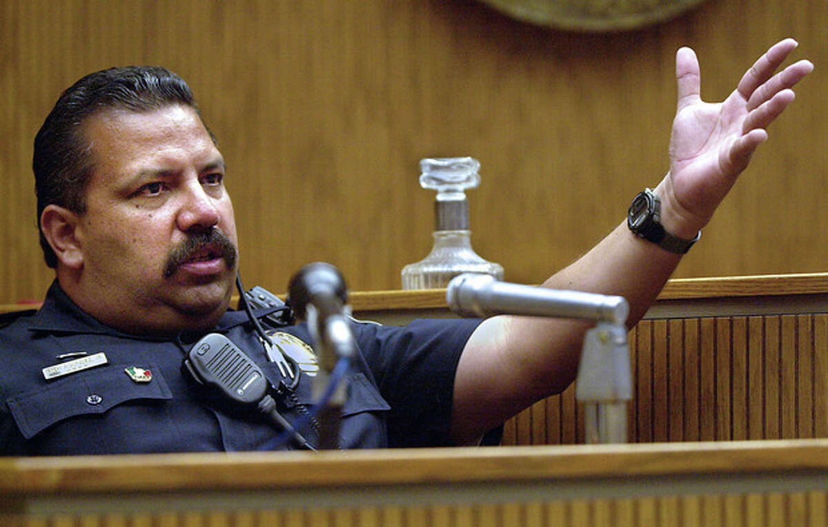 FILE - In this May 10, 2001, file photo, El Cajon, Calif., Police department school resource officer Rich Agundez Jr., who confronted and wounded a student who attacked Granite Hills High School with a shotgun in 2001, testifies in El Cajon. The National Rifle Association?'s response to a Connecticut school massacre envisions, in part, having trained, armed volunteers in every school in America. But Agundez, school safety experts and school board members say there?'s a huge difference between a trained law enforcement officer who becomes part of the school family _ and a guard with a gun. (AP Photo/U-T San Diego, John Gastaldo) SAN DIEGO COUNTY OUT; NO SALES; COMMERCIAL INTERNET OUT; FOREIGN OUT