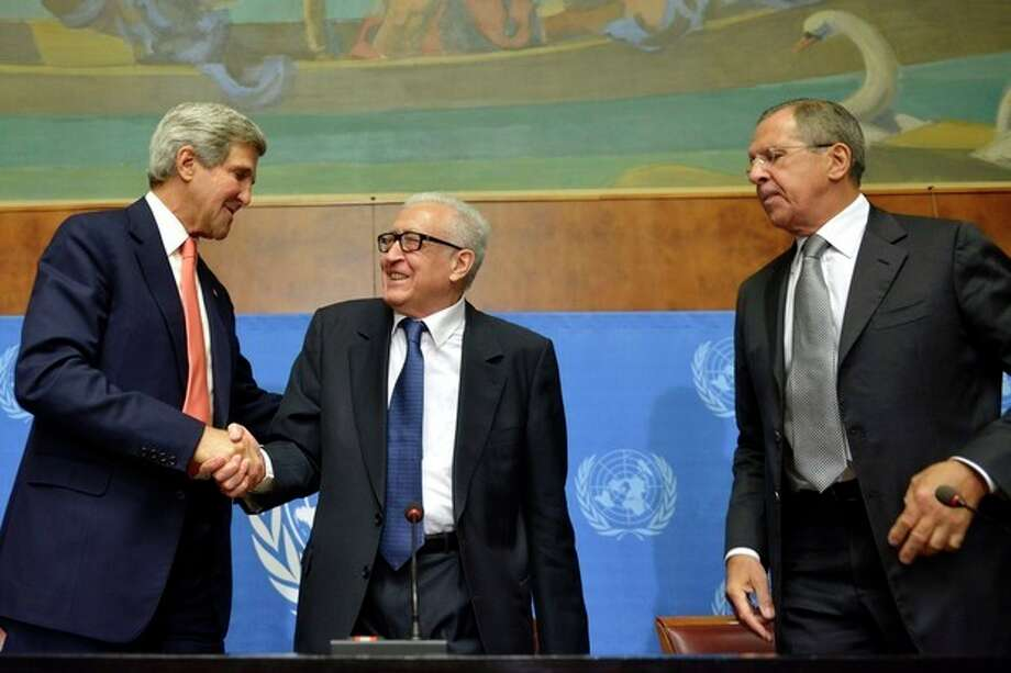 "John Kerry, left, US Secretary of State, shakes hands with Lakhdar Brahimi, center, UN Joint Special Representative for Syria, next to Sergei Lavrov, right, Russian Foreign Minister during a press conference after their meeting at the European headquarters of the United Nations in Geneva, Switzerland, Friday, Sept. 13, 2013. Kerry and Lavrov say the prospects for a resumption in the Syria peace process are riding on the outcome of their chemical weapons talks. Kerry, flanked by Lavrov and Brahimi, told reporters after an hour-long meeting that the chances for a second peace conference in Geneva ""will obviously depend on the capacity to have success here ... on the subject of the chemical weapons."" (AP Photo/Keystone, Martial Trezzini) / KEYSTONE"