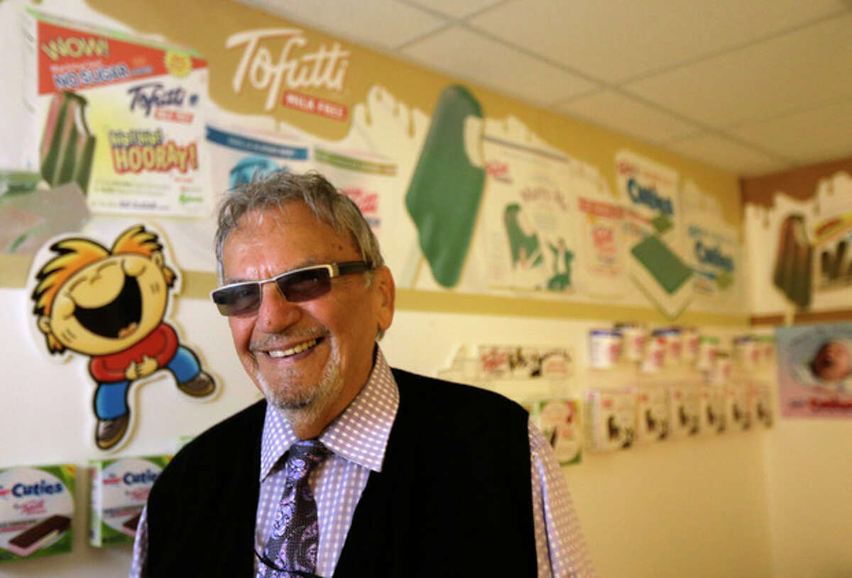 In this photo taken Aug. 23, 2013, David Mintz poses for The Associated Press inside his business, Tofutti, in Cranford, N.J. Mintz, the Tofutti CEO, maker of dairy-free products, says he wants his employees at Tofutti to have the trademarks of youth: energetic and enthusiastic, fresh thinking and quick to catch on, able to work at a frenzied pace, starting the day early and working late. He?'s finding them in older workers. (AP Photo/Julio Cortez)