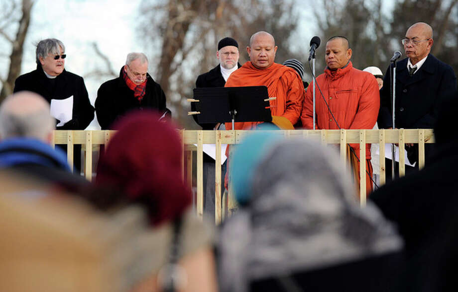 Members of the Newtown Interfaith Clergy Association lead a prayer vigil to remember the victims of the Sandy Hook elementary school shootings Friday, Dec. 28, 2012 in Newtown, Conn. Friday morning marked two weeks since a gunman killed 20 children and six educators at the Sandy Hook Elementary School. (AP Photo/Danbury News-Times, Carol Kaliff) / Danbury News-Times