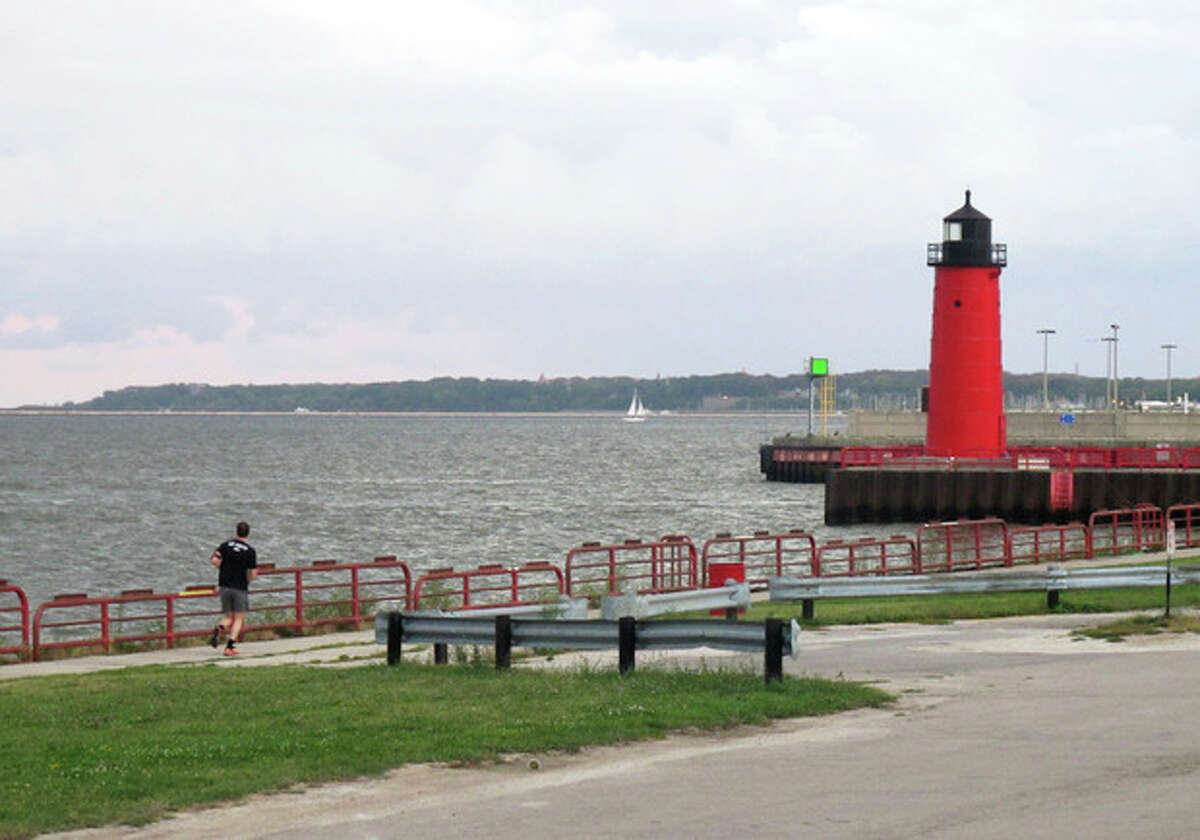 In this Sept. 12, 2013 photo a jogger runs along Milwaukee?'s Inner Harbor of Lake Michigan, a federal ?