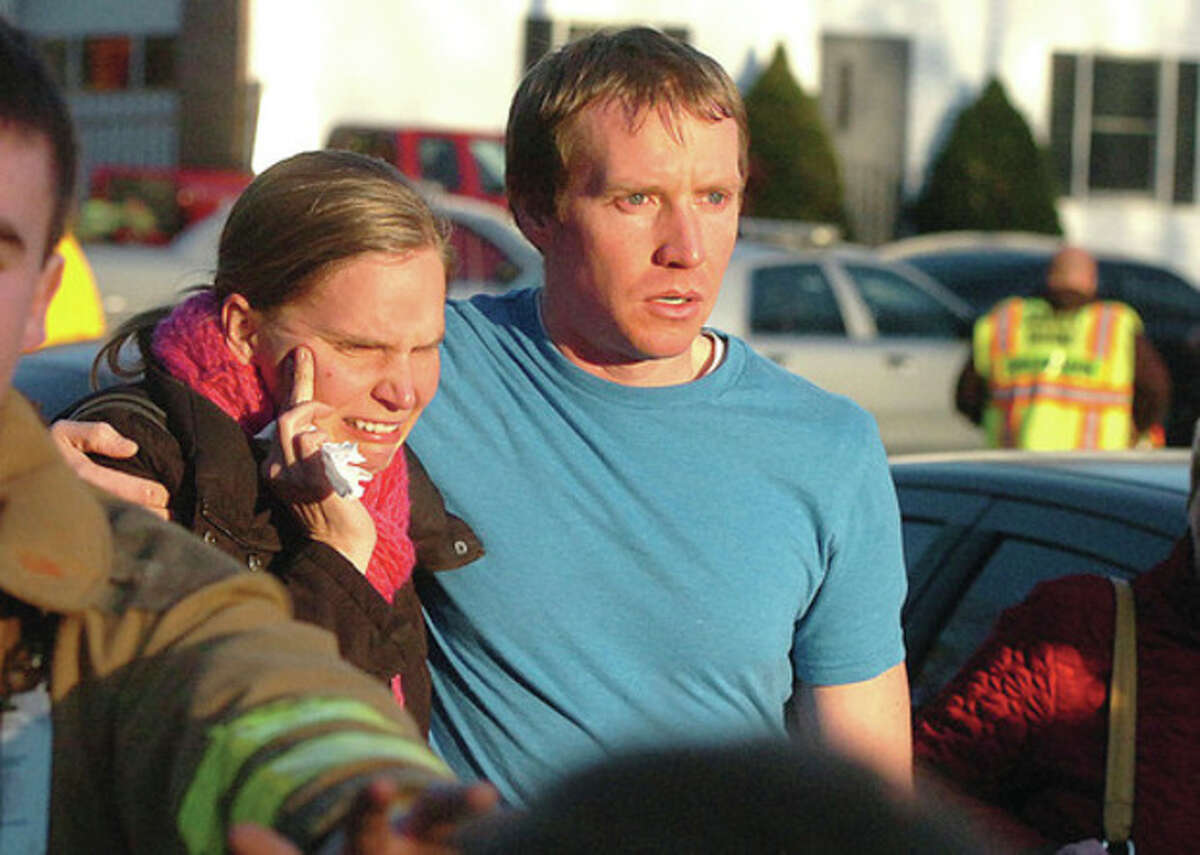 Hour Photo/Alex von Kleydorff People leave the Sandy Hook Volunteer Fire House in tears after a shooting massacre at The Sandy Hook School nearby on Friday morning.