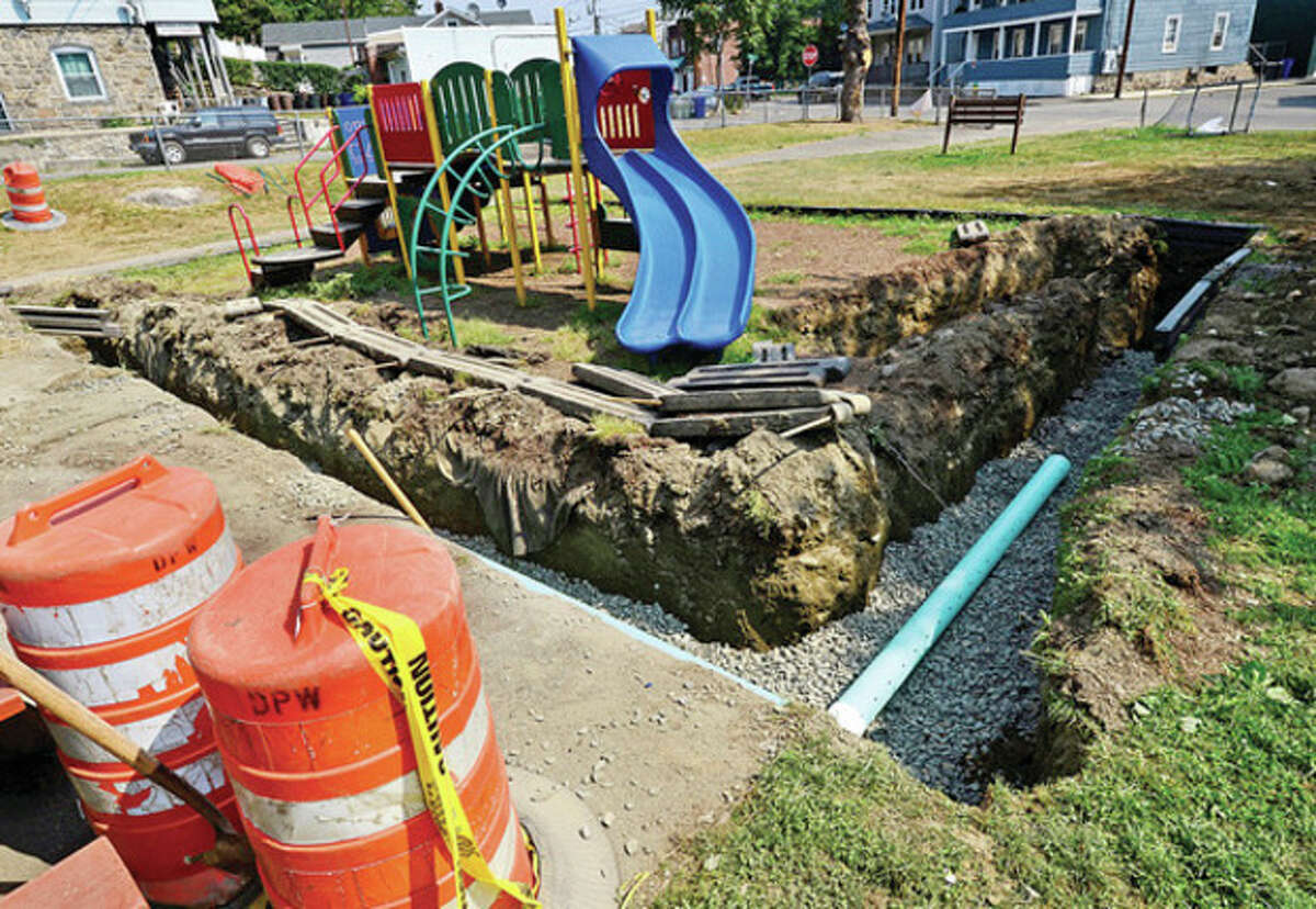 A new drainage system will save half of the existing playground as construction of new Bouton Street Park playground begins Thursday. Hour photo / Erik Trautmann