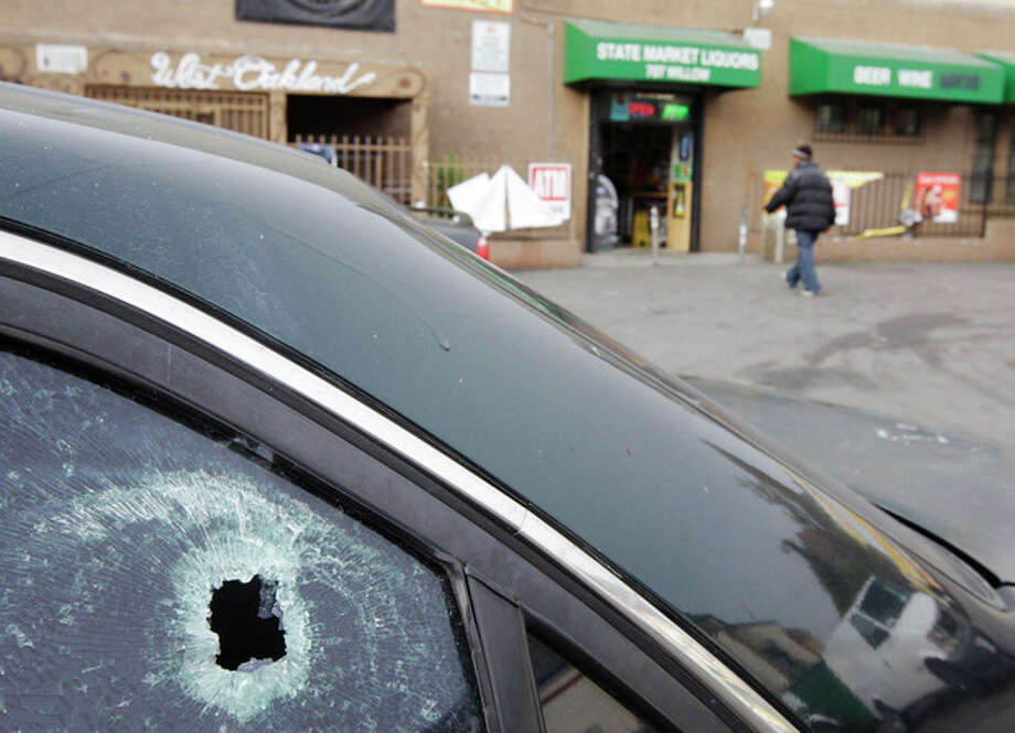 FILE - This Nov. 29, 2011 file photo shows a bullet hole in a window of a car at a liquor store parking lot in Oakland, Calif., after a shooting. A hail of gunfire along the Oakland street left eight people wounded, including a 1-year-old boy. In the wake of the Dec. 14, 2012 mass shooting at Sandy Hook Elementary School in the small town of Newtown, Conn., there is now much political discussion about gun control. For urban advocates, this new emphasis on gun control is long overdue. (AP Photo/Paul Sakuma, File) / AP