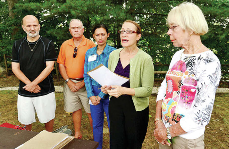 Hour photo / Erik TrautmannRolling Ridge Condominium residents from left, Robert Morgan, Lennox Stuart and Sally Dodd, right, join Norwalk Counciwoman at-large, Anna Duleep and Dianne Lauricella, center, at a press conference for the Norwalk Coalition for Sensible Development, a coalition of neighbors surrounding the proposed BJs Wholesale development located at 272-280 Main Ave. / (C)2013, The Hour Newspapers, all rights reserved