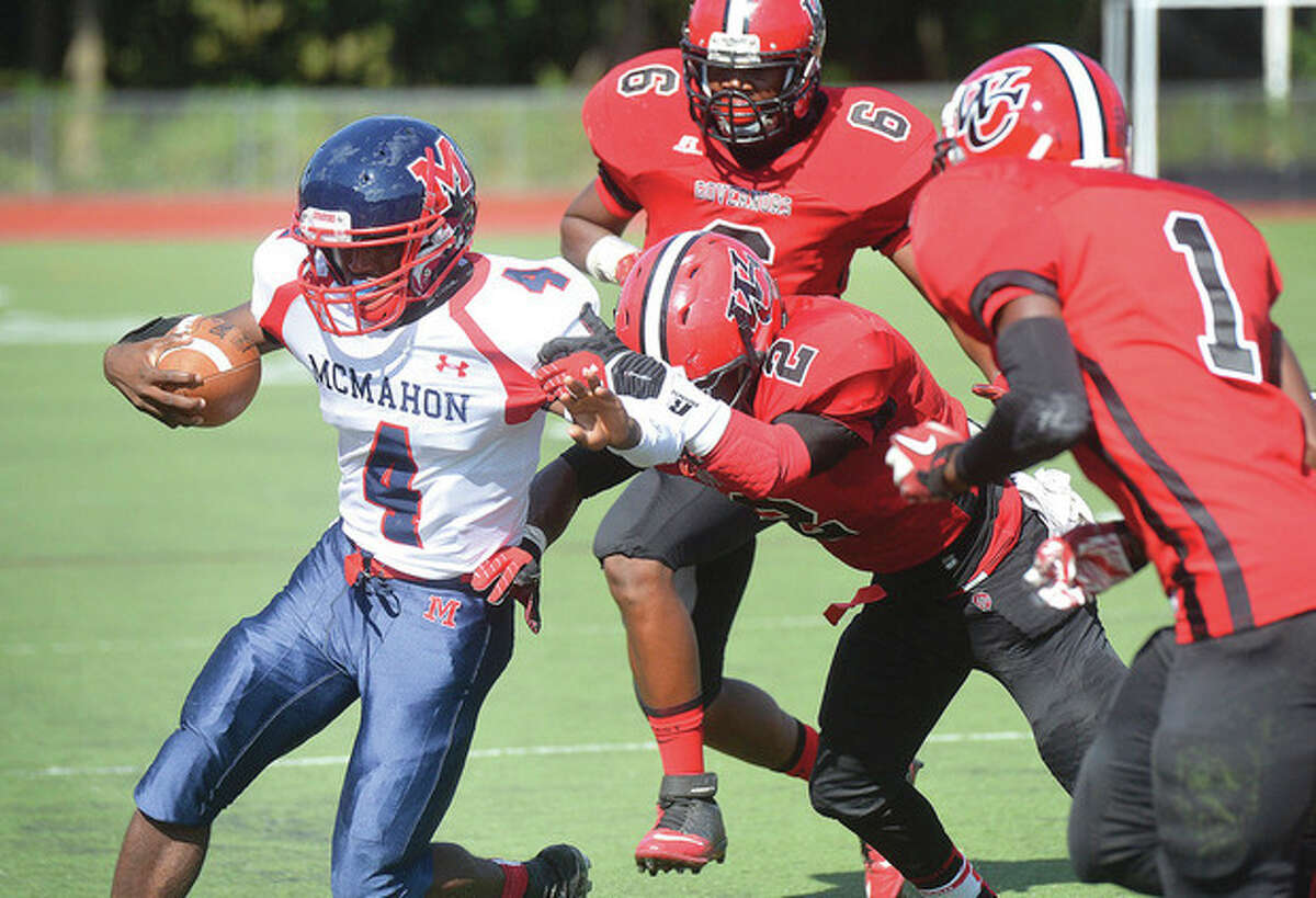 Hour Photo/Alex von Kleydorff. McMahons #4 runs up field but is brought out of bounds vs Wilbur Cross