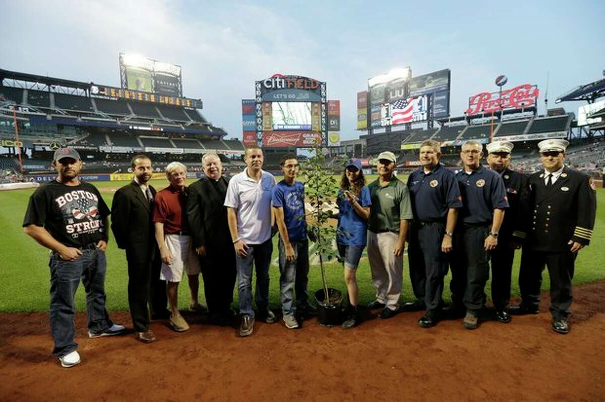 Prescott, Ariz., Wildland Division chief Darrell Eugene Willis, fourth from right, and Public Information officer Wade Michael Ward, third from right, pose with other recipients of the
