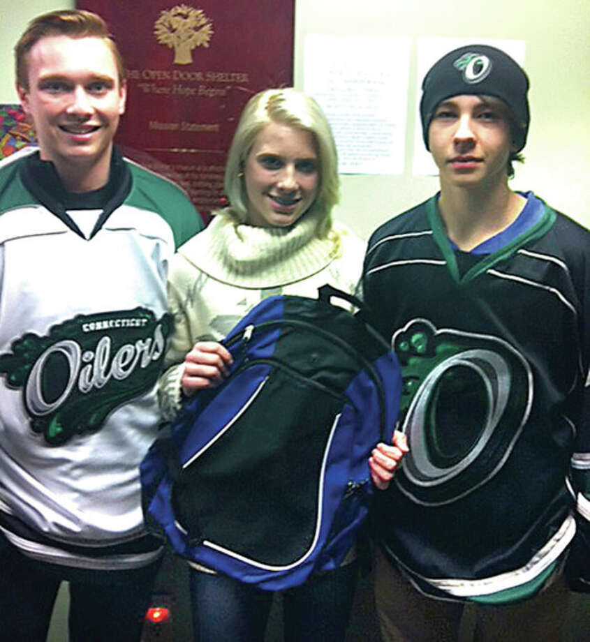 Contributed photoConnecticut Oiler players Erik Nergaard, left, of Stamford, and Declyn Thornton, right, along with Kirsten Nergaard, who plays at Phillips Exeter in New Hampshire, have already donated fifty backpacks to The Open Door Shelter in South Norwalk.