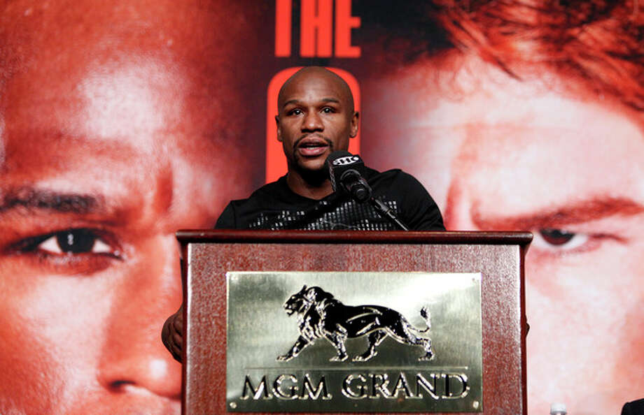 Boxer Floyd Mayweather speaks during a press conference in Las Vegas, Wednesday, Sept. 11, 2013. Mayweather is scheduled to fight on Saturday against Carnelo Alvarez, for Mayweather's WBA Super World and Alvarez's WBC junior middleweight titles. (AP Photo/Las Vegas Review-Journal, John Locher) LOCAL TV OUT; LOCAL INTERNET OUT; LAS VEGAS SUN OUT / Las Vegas Review-Journal