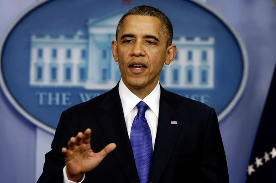 President Barack Obama speaks to reporters about the fiscal cliff in the Brady Press Briefing Room at the White House in Washington, Friday, Dec. 21, 2012. (AP Photo/Charles Dharapak) / AP