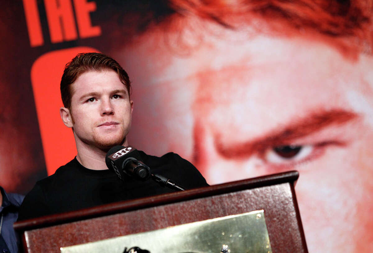 Boxer Carnelo Alvarez speaks during a press conference in Las Vegas, Wednesday, Sept. 11, 2013. Alvarez is scheduled to fight on Saturday against Floyd Mayweather, for Mayweather's WBA Super World and Alvarez's WBC junior middleweight titles. (AP Photo/Las Vegas Review-Journal, John Locher) LOCAL TV OUT; LOCAL INTERNET OUT; LAS VEGAS SUN OUT