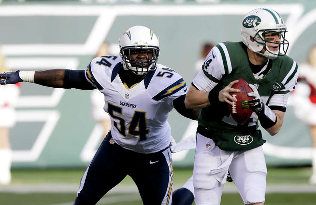 San Diego Chargers outside linebacker Melvin Ingram (54) chases after New York Jets quarterback Greg McElroy (14) during the first half of an NFL football game on Sunday, Dec. 23, 2012, in East Rutherford, N.J. (AP Photo/Kathy Willens)
