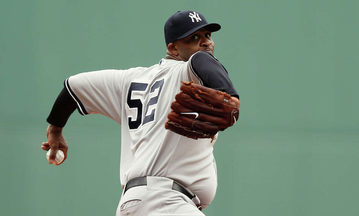 New York Yankees starting pitcher CC Sabathia delivers against the Boston Red Sox during the first inning of a baseball game at Fenway Park in Boston Saturday, Sept. 14, 2013. (AP Photo/Winslow Townson)