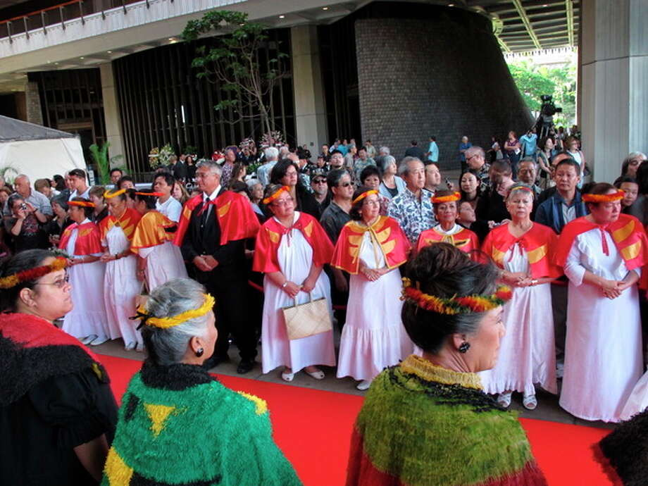 Members of the public wait for the casket to arrive at a visitation service for U.S. Sen. Daniel Inouye at the Hawaii state Capitol in Honolulu on, Dec. 22, 2012. (AP Photo/Oskar Garcia) / AP