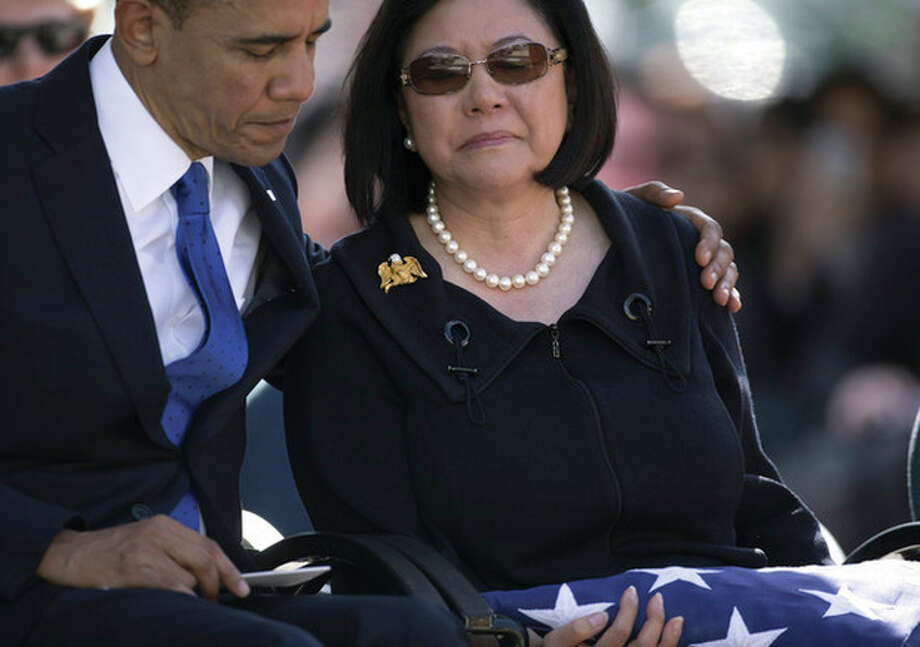 AP photo /Carolyn KasterPresident Barack Obama comforts Irene Hirano Inouye, the widow of the late Sen. Daniel Inouye, at the National Memorial Cemetery of the Pacific Sunday in Honolulu. Inouye was the first Japanese-American elected to both houses of Congress and the second-longest serving senator in U.S. history. / AP