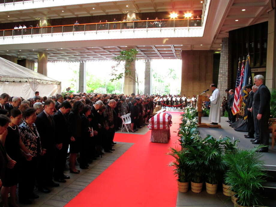 Family members, state lawmakers and members of the public attend a visitation service for U.S. Sen. Daniel Inouye at the Hawaii state Capitol in Honolulu on Saturday Dec. 22, 2012. (AP Photo/Oskar Garcia) / AP