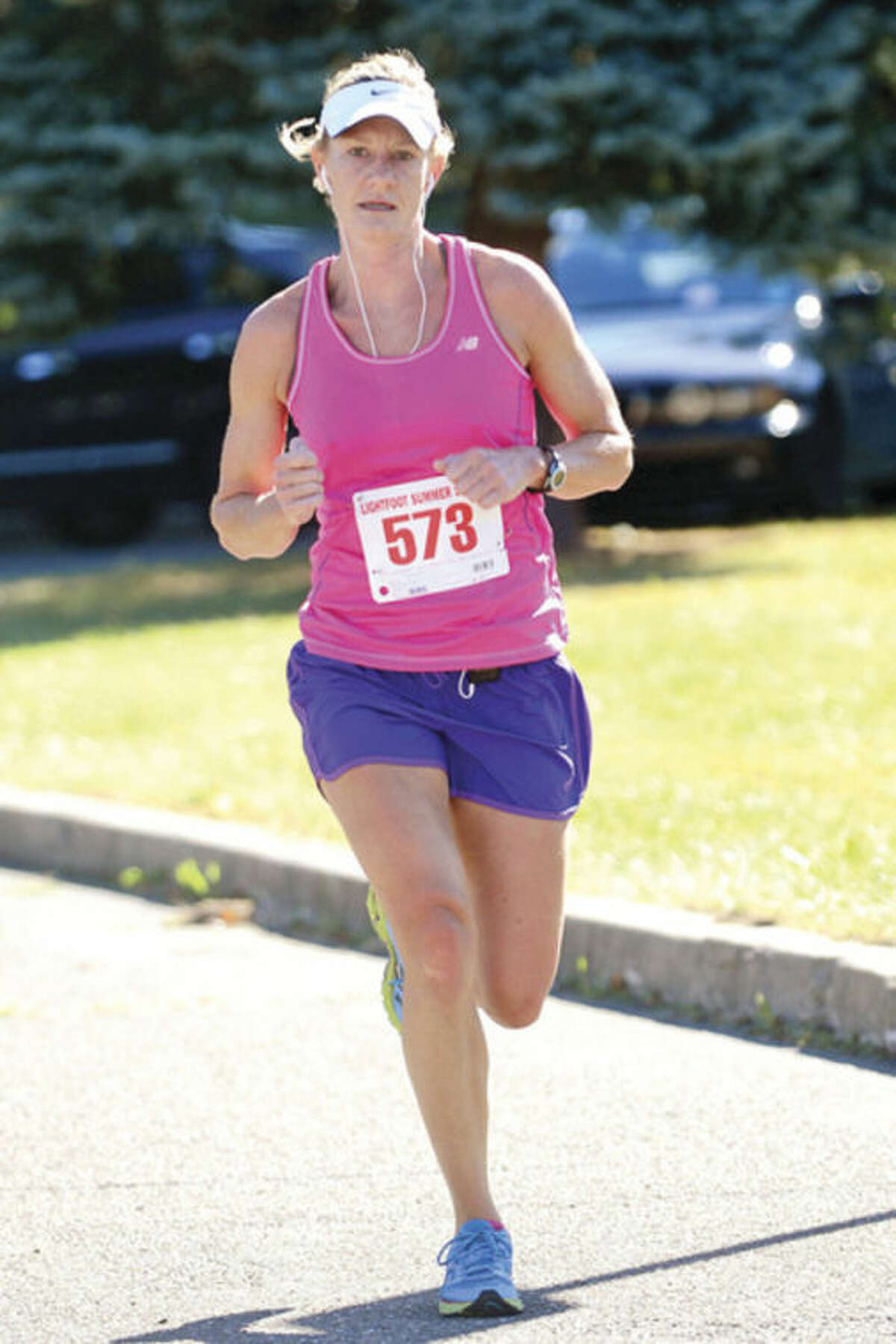 Lisa Martin is the first women finisher in The Lightfoot Running Club and the Norwalk Recreation and Parks Department 36th annual Sam Elpern Memorial Half-Marathon Saturday at Fox Run Elementary School. Hour photo / Erik Trautmann