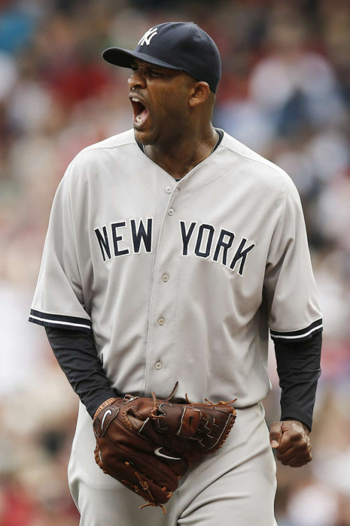 New York Yankees starting pitcher CC Sabathia shouts out while leaving the mound after giving up a run to the Boston Red Sox during the fourth inning of a baseball game at Fenway Park in Boston Saturday, Sept. 14, 2013. (AP Photo/Winslow Townson)