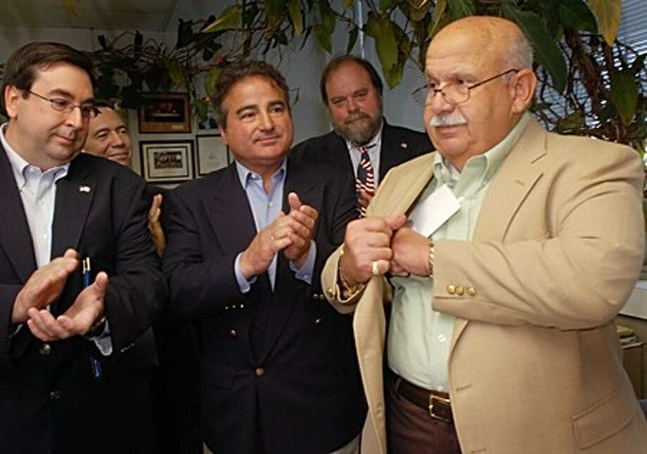 Norwalk republicans Art Scialabba, Cesar Ramirez, Nicholas Kydes and Doug Hempstead applaud the decision of longtime Democrat Fred Bondi to register as a republican during a press conference at City Hall Tuesday. Hour photo / Erik Trautmann