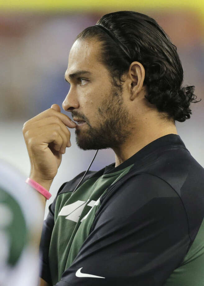 New York Jets quarterback Mark Sanchez watches from the sideline as the Jets play the New England Patriots in the first half an NFL football game Thursday, Sept. 12, 2013, in Foxborough, Mass. (AP Photo/Charles Krupa)