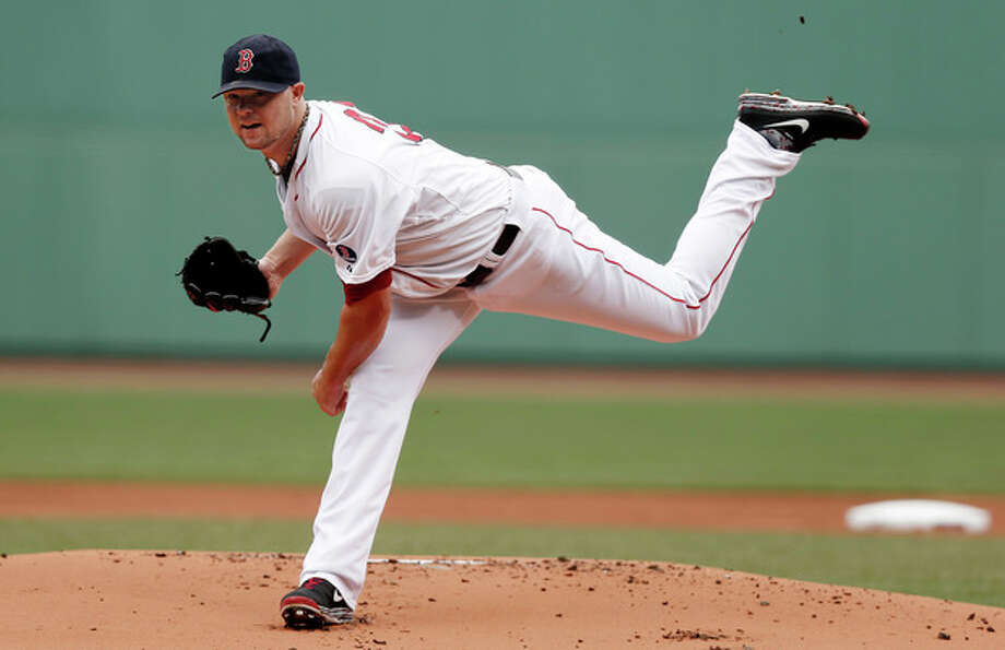 Boston Red Sox starting pitcher Jon Lester delivers against the New York Yankees during the first inning of a baseball game at Fenway Park in Boston Saturday, Sept. 14, 2013. (AP Photo/Winslow Townson) / FR170221 AP