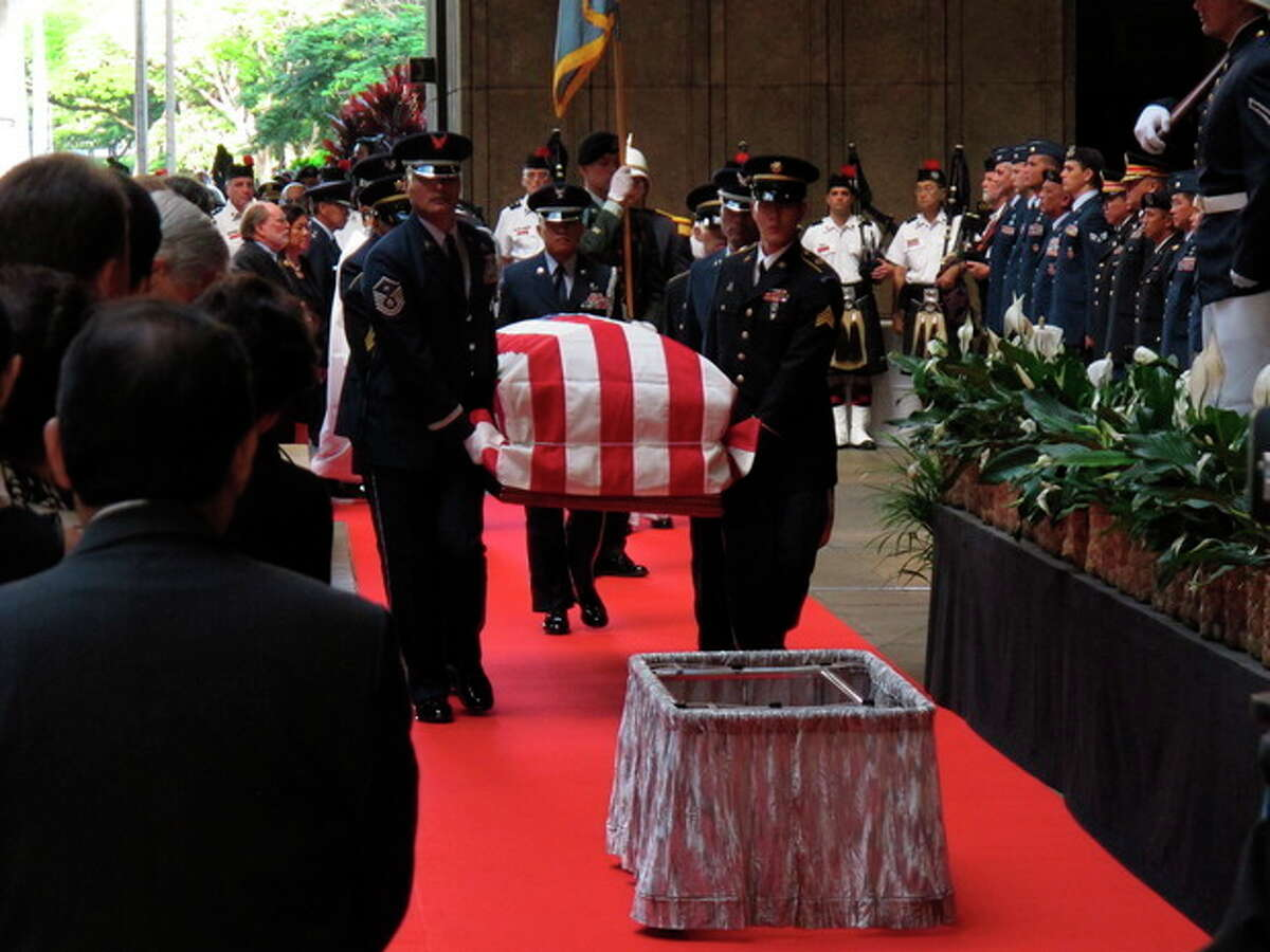 Pallbearers carry the casket of U.S. Sen. Daniel Inouye into the courtyard of the Hawaii state Capitol during a visitation ceremony in Honolulu on, Saturday Dec. 22, 2012. (AP Photo/Oskar Garcia)