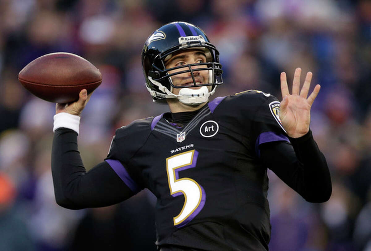 Baltimore Ravens quarterback Joe Flacco throws to a receiver in the first half of an NFL football game against the New York Giants in Baltimore, Sunday, Dec. 23, 2012. (AP Photo/Evan Vucci)