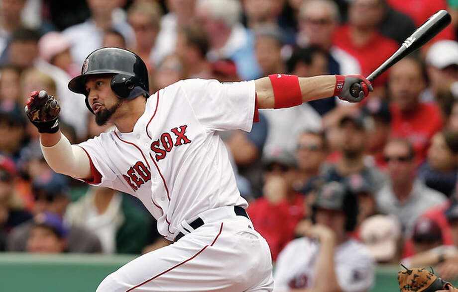 Boston Red Sox's Shane Victorino follows through with an RBI single against the New York Yankees during the fourth inning of a baseball game at Fenway Park in Boston Saturday, Sept. 14, 2013. (AP Photo/Winslow Townson) / FR170221 AP