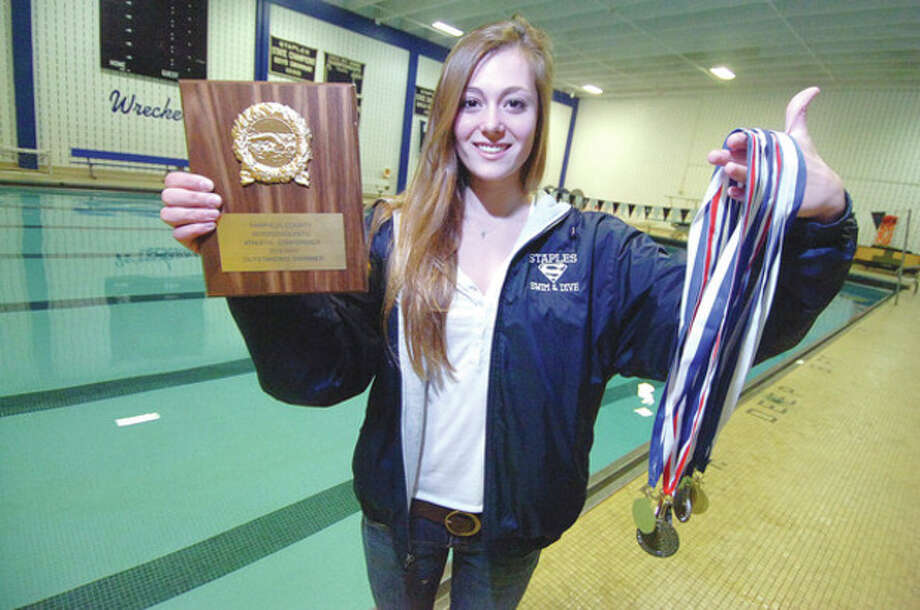 Hour Photo/Alex von KleydorffVerity Abel of Staples High School in Westport shows off some of the spoils she earned during the 2012 girls swimming season, which ends with her earning one more accolade -- The Hour's All-Area Swim MVP. / 2012 The Hour Newspapers/Alex von Kleydorff
