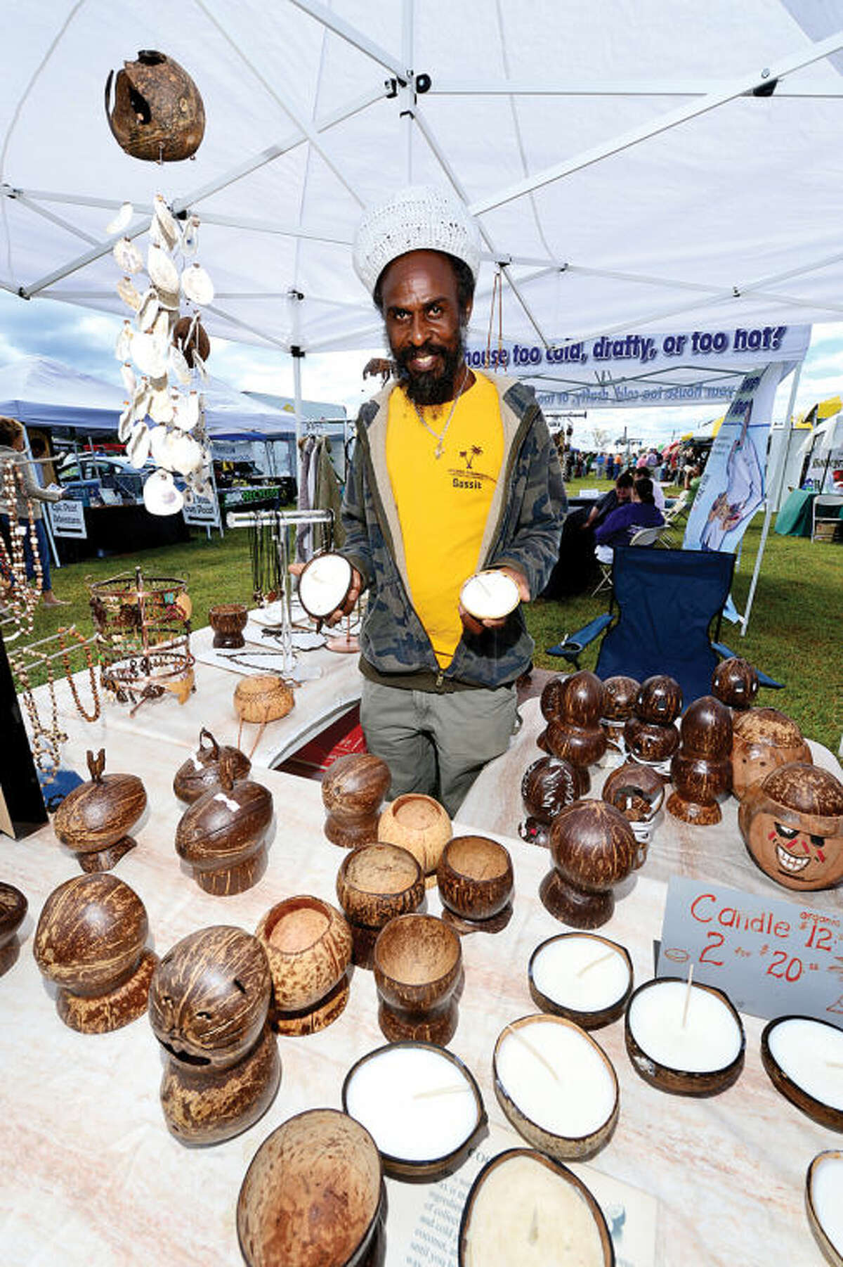 Gussie Bradford displays coconut candles from Organic Ornaments during the Live Green Connecticut! green-living and family festival Saturday at Taylor Farm Park. The two-day festival promotes living green with a focus on education, sustainability, caring for the environment and our natural resources.Hour photo / Erik Trautmann