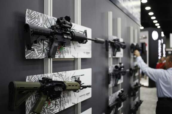AR-15 rifles are displayed at the SIG Sauer GmbH booth on the exhibit floor during the National Rifle Association (NRA) annual meeting in Louisville, Kentucky, U.S., on Friday, May 20, 2016. The nation's largest gun lobby, the NRA has been a political force in elections since at least 1994, turning out its supporters for candidates who back expanding access to guns. Photographer: Luke Sharrett/Bloomberg