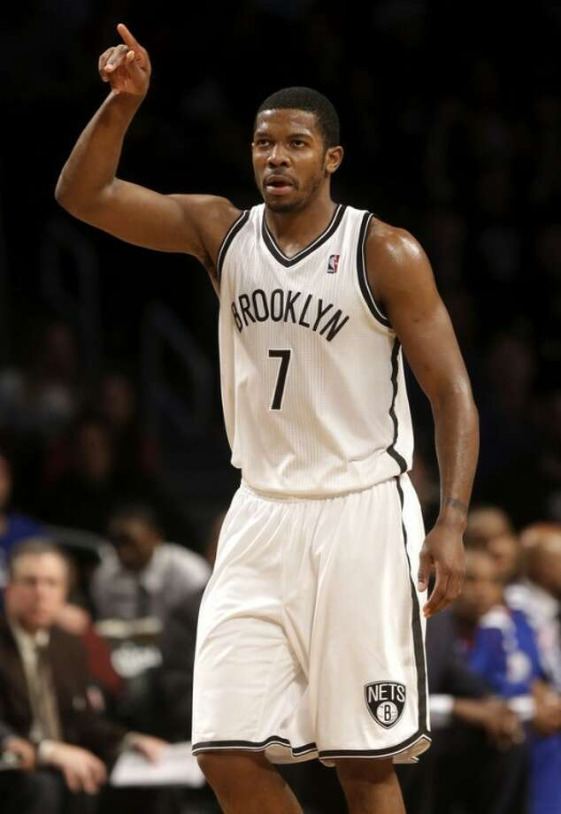 Brooklyn Nets' Joe Johnson reacts after hitting a three-point basket during the second half of the NBA basketball game at the Barclays Center Sunday, Dec. 23, 2012 in New York. The Nets beat the 76ers 95-92. (AP Photo/Seth Wenig)