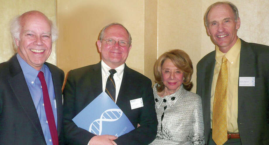 Contributed photosAbove, from left to right: Dusty Miller, Michael Lotze, ACGT Co-Founder Barbara Netter and Dr. Carl June at ACGT's 10th Anniversary dinner. Below, from left to right, Margaret Cianci, ACGT executive director, and Dr. June.