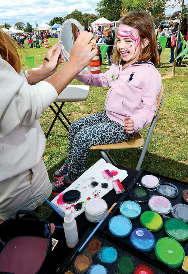 Madison Farrer,5, gets her face painted during the Live Green Connecticut! green-living and family festival Saturday at Taylor Farm Park. The two-day festival promotes living green with a focus on education, sustainability, caring for the environment and our natural resources.Hour photo / Erik Trautmann