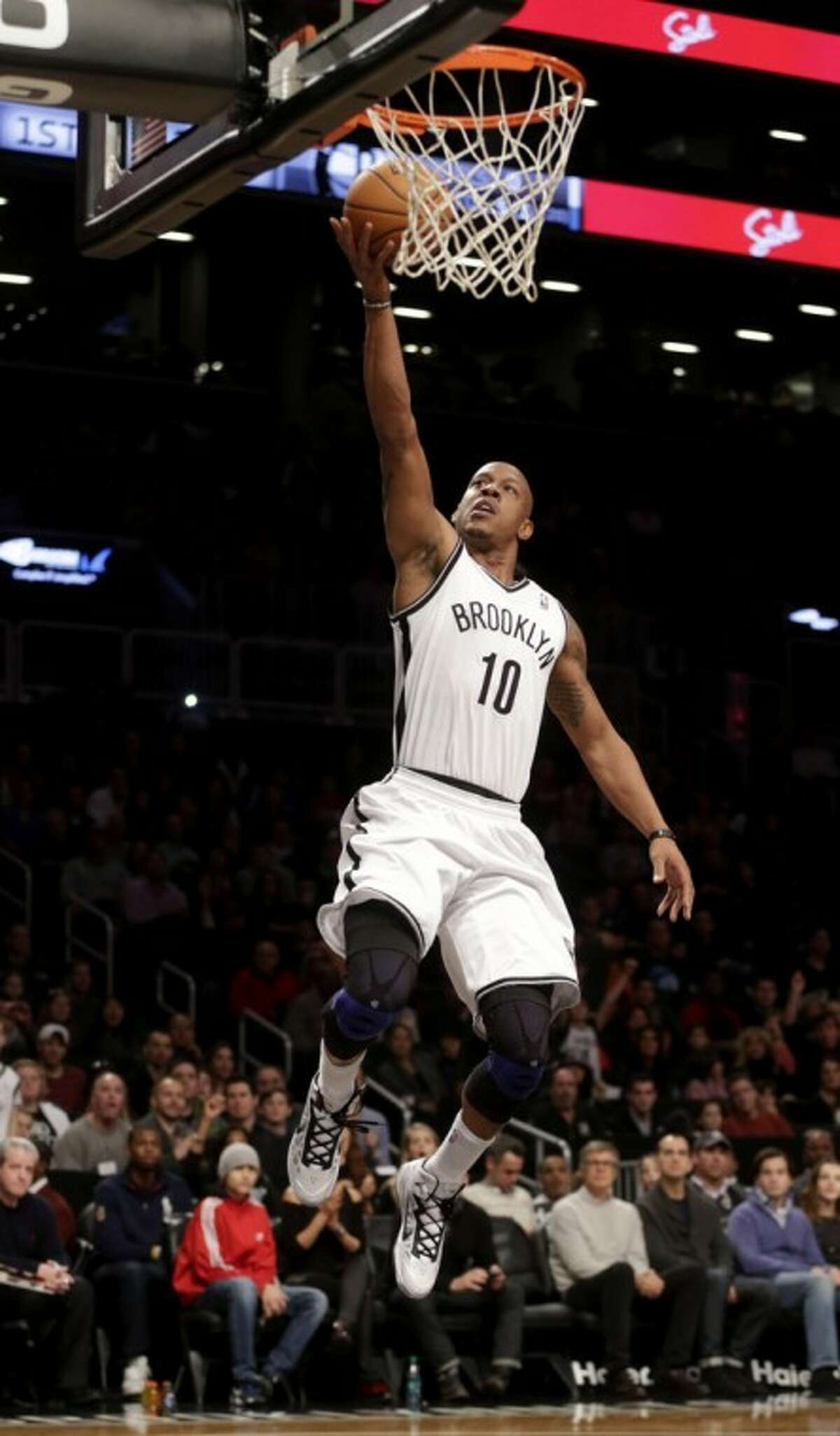 Brooklyn Nets' Keith Bogans makes a basket on a breakaway during the first half of an NBA basketball game against the Philadelphia 76ers at the Barclays Center Sunday, Dec. 23, 2012 in New York. (AP Photo/Seth Wenig)