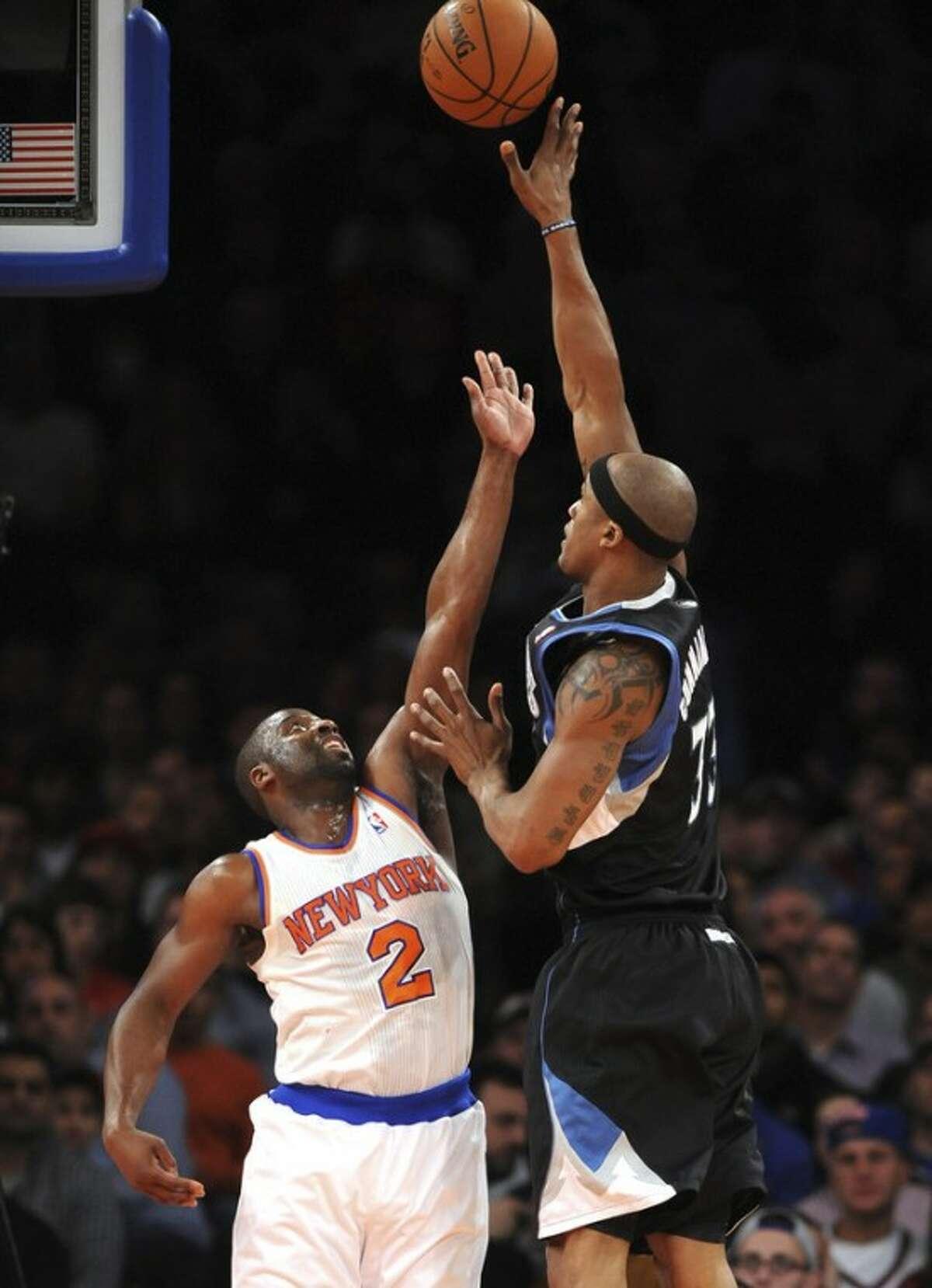 Minnesota Timberwolves' Dante Cunningham (33) shoots over New York Knicks' Raymond Felton (2) in the first half of an NBA basketball game on Sunday, Dec., 23, 2012, at Madison Square Garden in New York. (AP Photo/Kathy Kmonicek)
