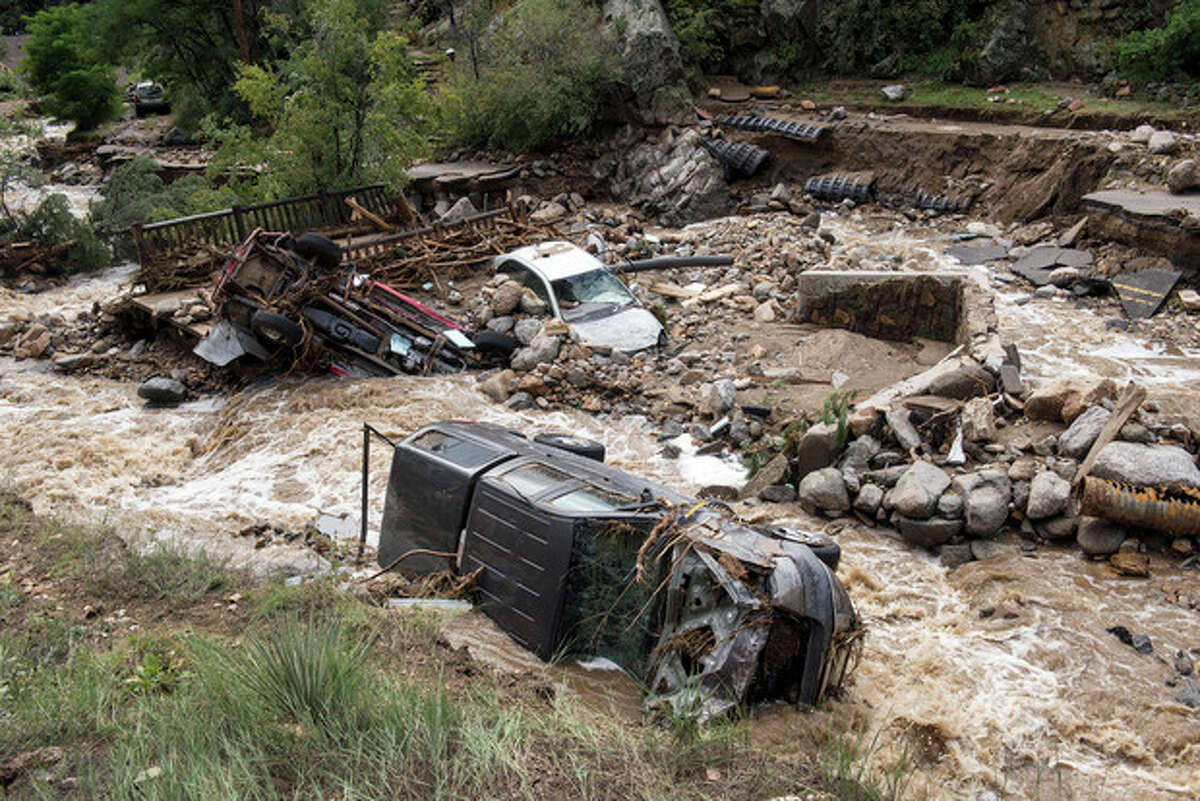 This Sept. 13, 2013 photo provided by Earth Vision Trust shows destruction on Gold Run Creek north of Boulder, Colo., on Sept. 13, 2013. The destructive force took out many homes, cars, trees, and completely washed out Gold Run Road. By air and by land, the rescue of hundreds of Coloradoans stranded by epic mountain flooding accelerated Saturday as debris-filled rivers became muddy seas that extended into towns and farms miles from the Rockies. (AP Photo/Courtesy of Earth Vision Trust, Matthew Kennedy)
