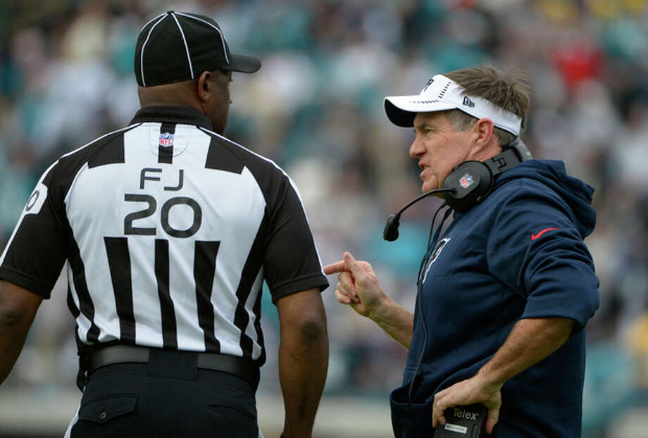New England Patriots head coach Bill Belichick, right, talks to field judge Barry Anderson during the second half of an NFL football game against the Jacksonville Jaguars in Jacksonville, Fla., Sunday, Dec. 23, 2012. The Patriots won 23-16. (AP Photo/Phelan M. Ebenhack) / FR121174 AP
