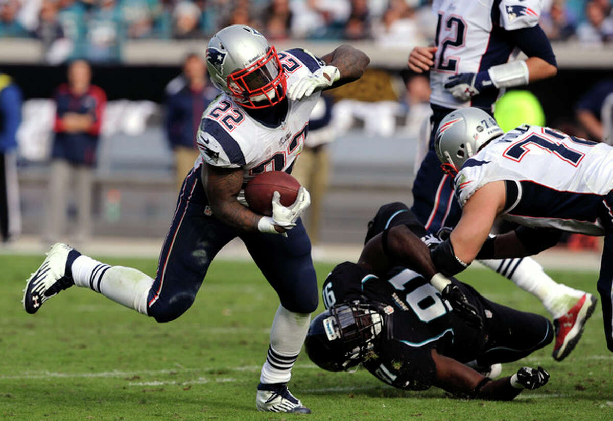New England Patriots running back Stevan Ridley (22) runs around the corner during the second half of an NFL football game against the Jacksonville Jaguars, Sunday, Dec. 23, 2012, in Jacksonville, Fla. The Patriots defeated the Jaguars 23-16.(AP Photo/Stephen Morton)