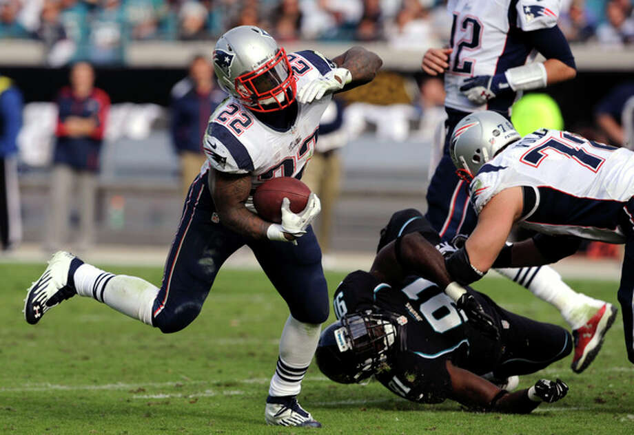 New England Patriots running back Stevan Ridley (22) runs around the corner during the second half of an NFL football game against the Jacksonville Jaguars, Sunday, Dec. 23, 2012, in Jacksonville, Fla. The Patriots defeated the Jaguars 23-16.(AP Photo/Stephen Morton) / FR56856 AP