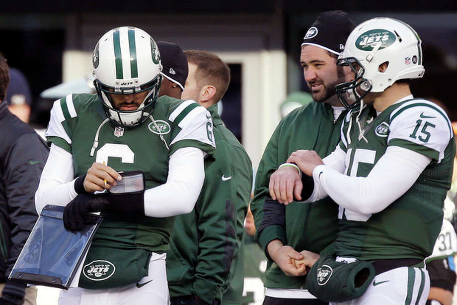 New York Jets quarterbacks Mark Sanchez (6) and Tim Tebow (15) stand next to each other on the sideline during the first half of an NFL football game against the San Diego Chargers, Sunday, Dec. 23, 2012, in East Rutherford, N.J. (AP Photo/Kathy Willens) / AP