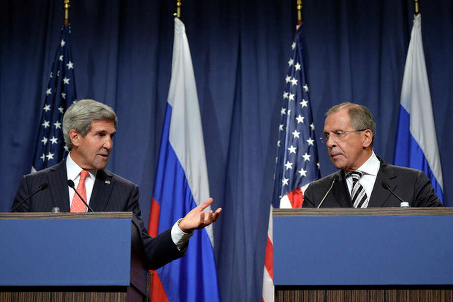 U.S. Secretary of State John Kerry, left, and Russian Foreign Minister Sergei Lavrov, right, deliver statements in Geneva, Switzerland, Saturday Sept. 14, 2013. U.S. Secretary of State Kerry and Russian Foreign Minister Lavrov said Saturday they have reached an agreement on a framework for Syria to destroy all of its chemical weapons, and would seek a U.N. Security Council resolution that could authorize sanctions, short of military action, if Syrian President Bashar Assad's government fails to comply. (AP Photo/Keystone,Martial Trezzini) / KEYSTONE
