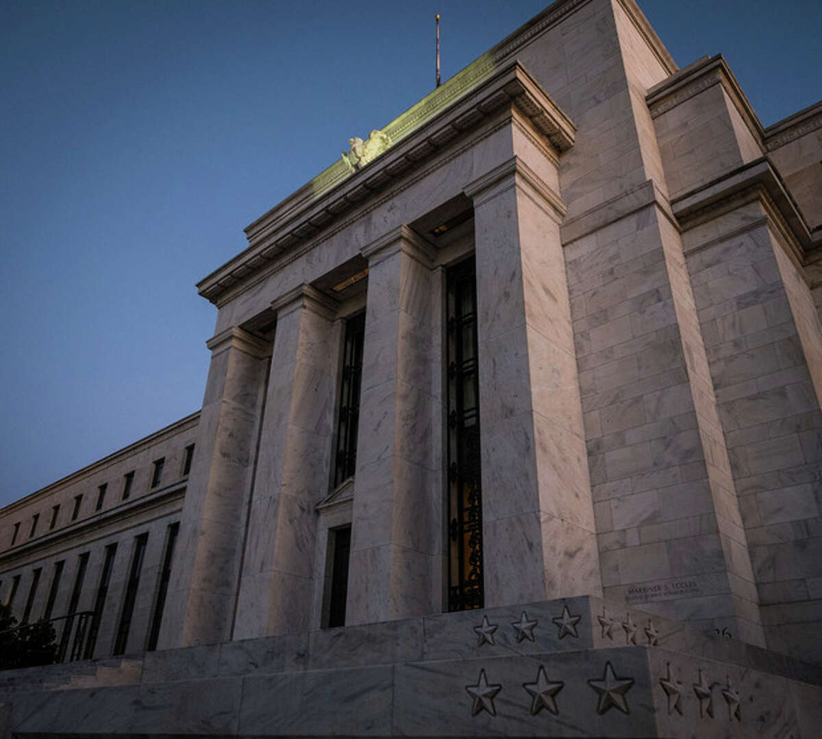 The Federal Reserve headquarters stands in Washington on Wednesday, Sept. 18, 2013. During its policy meeting on Wednesday, the Federal Reserve is expected to take its first step toward slowing the economic stimulus it's supplied since the financial crisis and the Great Recession five years ago. (AP Photo/J. David Ake)