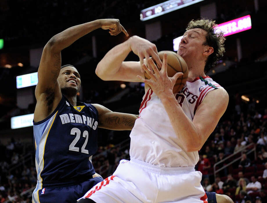 Houston Rockets' Omer Asik (3) grabs a rebound in front of Memphis Grizzlies' Rudy Gay (22) in the second half of an NBA basketball game on Saturday, Dec. 22, 2012, in Houston. The Rockets won 121-96. (AP Photo/Pat Sullivan) / AP